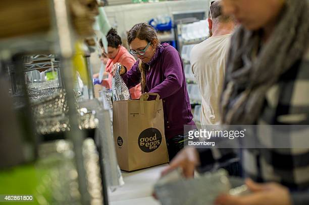 Employees pack food at the Good Eggs distribution center in San Francisco California US on Wednesday Feb 4 2015 Good Eggs is a technology company...
