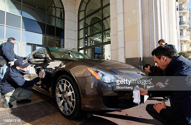 Employees polish a new Quattroporte automobile produced by Maserati the luxuryauto maker owned by Fiat SpA as it stands on display during its debut...