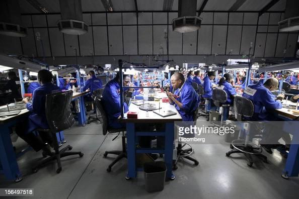 Employees polish and finish diamonds at workstations at the Shrenuj Botswana Ltd sightholder office in Gaborone Botswana on Thursday Oct 25 2012 De...