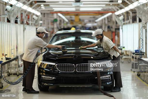 Employees polish the hood of a BMW 530i sedan on the production line at a PT Gaya Motor plant in Jakarta Indonesia on Wednesday Aug 2 2017 BMW is...