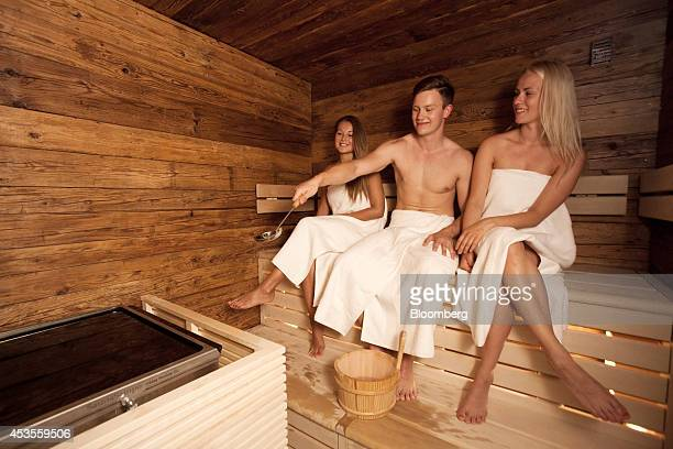 Employees pose for a photograph in the sauna for Finnair Oyj airline's business class passengers during a media event at HelsinkiVantaa airport in...