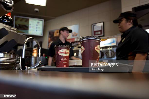 Employees prepare an order at a Tim Hortons Inc restaurant in Oakville Ontario Canada on Monday Sept 16 2013 Tim Hortons Inc Chief Executive Officer...