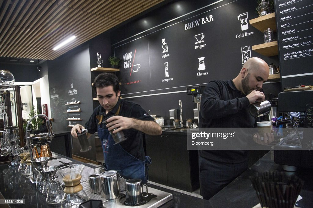 Employees prepare coffee at Banco Santander Chile's Work/Cafe in Santiago, Chile, on Wednesday, Aug. 16, 2017. Banco Santander Chile is the largest bank in the region in terms of total assets and equity. Photographer: Cristobal Olivares/Bloomberg via Getty Images