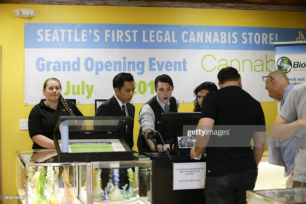 Employees prepare for opening day at the Cannabis City retail marijuana store on July 8, 2014 in Seattle, Washington. Cannabis City was the first retail marijuana store to open in Seattle today and one of the first group now operating in Washington state, nearly a year and a half after the state's voters chose to legalize marijuana for recreational use.
