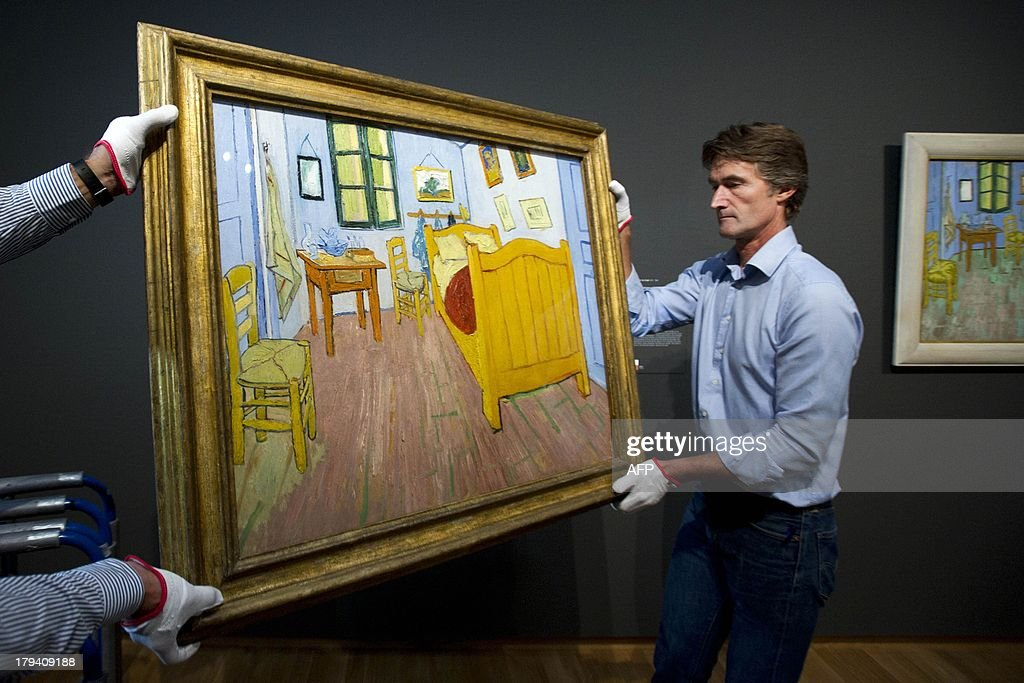 Employees prepare to hang the second version of the painting 'The bedroom' by Vincent van Gogh on September 3 2013 at the Van Gogh Museum in...