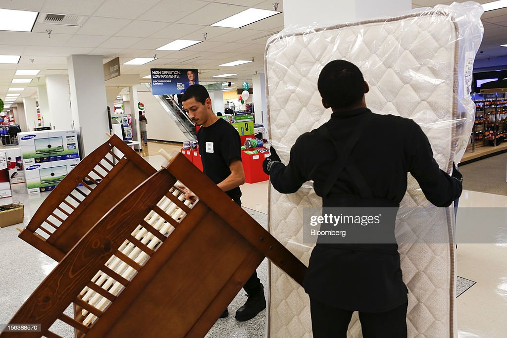 Employees prepare to load a bed and mattress set for a customer at a Sears store during the Family and Friends evening sale inside the Del Amo shopping mall in Torrance, California, U.S., on Sunday, Nov. 11, 2012. Sears Holdings Corp. is scheduled to announce earnings results on Nov. 15 before the opening of U.S. financial markets. Photographer: Patrick Fallon/Bloomberg via Getty Images