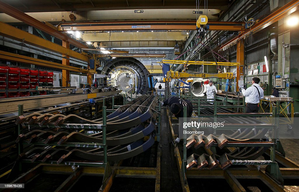 Employees prepare to move copper rods from storage ahead of use in the turbogenerator assembly unit at Ansaldo Energia SpA's power plant production facility in Genoa, Italy, on Friday, Jan. 18, 2013. Finmeccanica SpA is seeking binding bids for assets, including a majority stake in Ansaldo Energia, by Jan. 23, while a final decision will be made at a later board meeting, Ansa reported Jan. 16. Photographer: Alessia Pierdomenico/Bloomberg via Getty Images