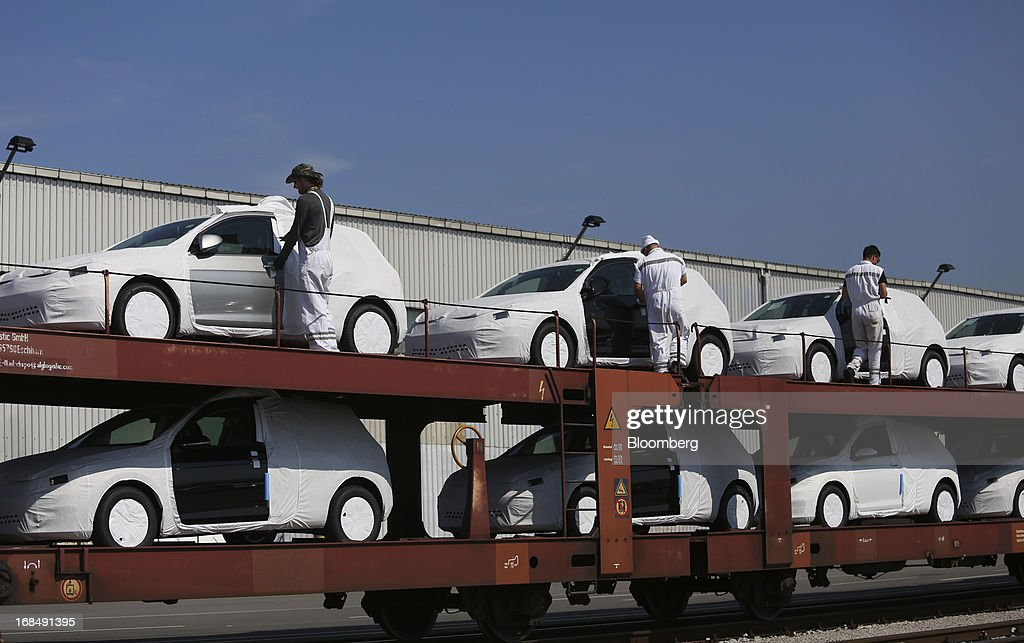 Employees prepare to unload new Volkswagen AG automobiles from a rail wagon at the port of Koper, operated by Luka Koper d.d., in Koper, Slovenia, on Thursday, May 9, 2013. The former Yugoslav nation, mired in its second recession since 2009, will contract this year and next, according to a May 3 report by the European Commission. Photographer: Chris Ratcliffe/Bloomberg via Getty Images