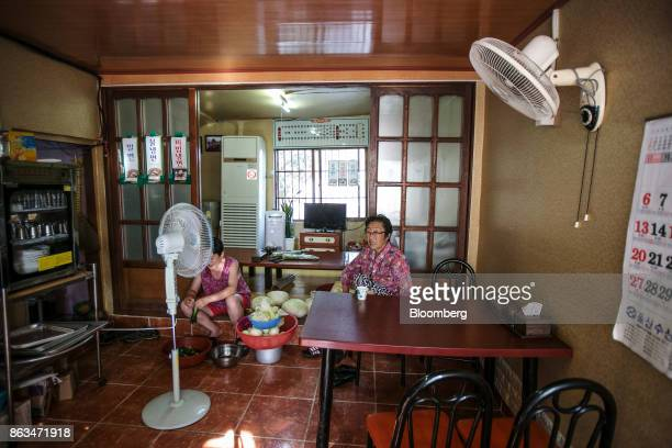 Employees prepare vegetables inside a restaurant in Ulju Ulsan province South Korea on Thursday Aug 31 2017 South Korea has the worlds sixthlargest...