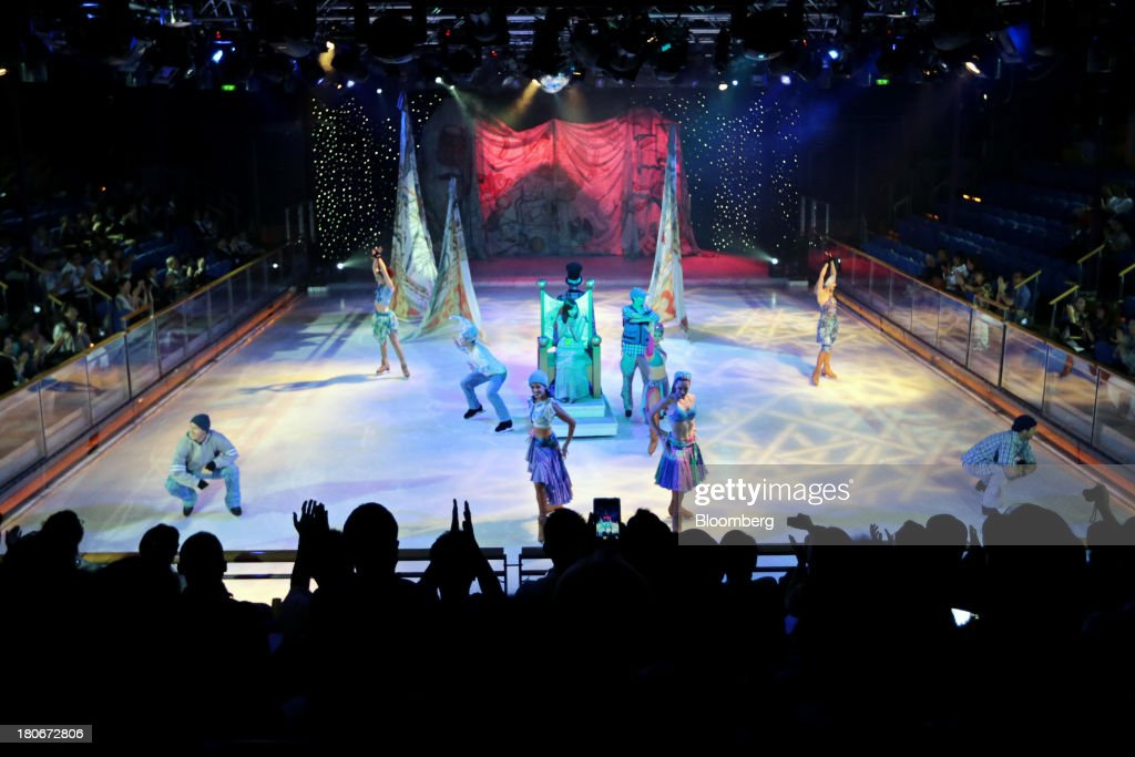 Employees present a complimentary ice-skating show aboard the Royal Caribbean Cruises Ltd.'s Voyager of the Seas, berthed at the Ohi wharf in Tokyo, Japan, on Saturday, Sept. 14, 2013. Royal Caribbean, the worlds second-largest cruise-line operator, doubled its dividend and will make directors stand for election every year. Photographer: Yuriko Nakao/Bloomberg via Getty Images