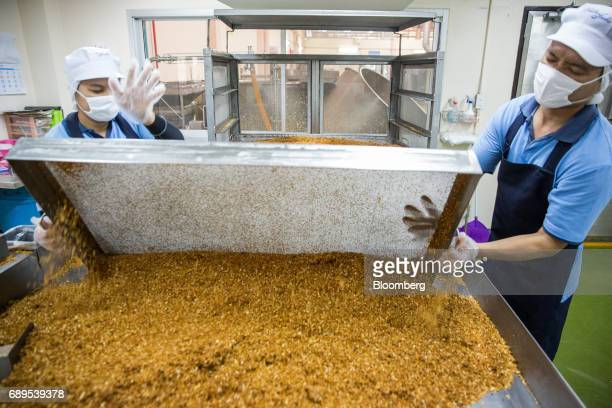 Employees process garlic at the Nithi Foods Co factory in the San Pa Tong district of Chiang Mai Thailand on Tuesday May 23 2017 Thailand's consumer...