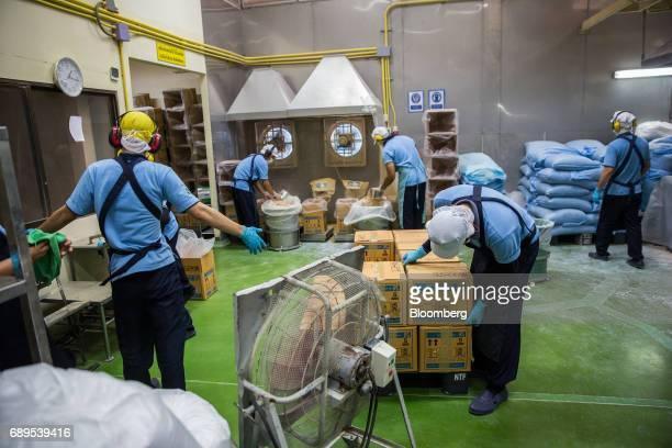 Employees process garlic powder at the Nithi Foods Co factory in the San Pa Tong district of Chiang Mai Thailand on Tuesday May 23 2017 Thailand's...