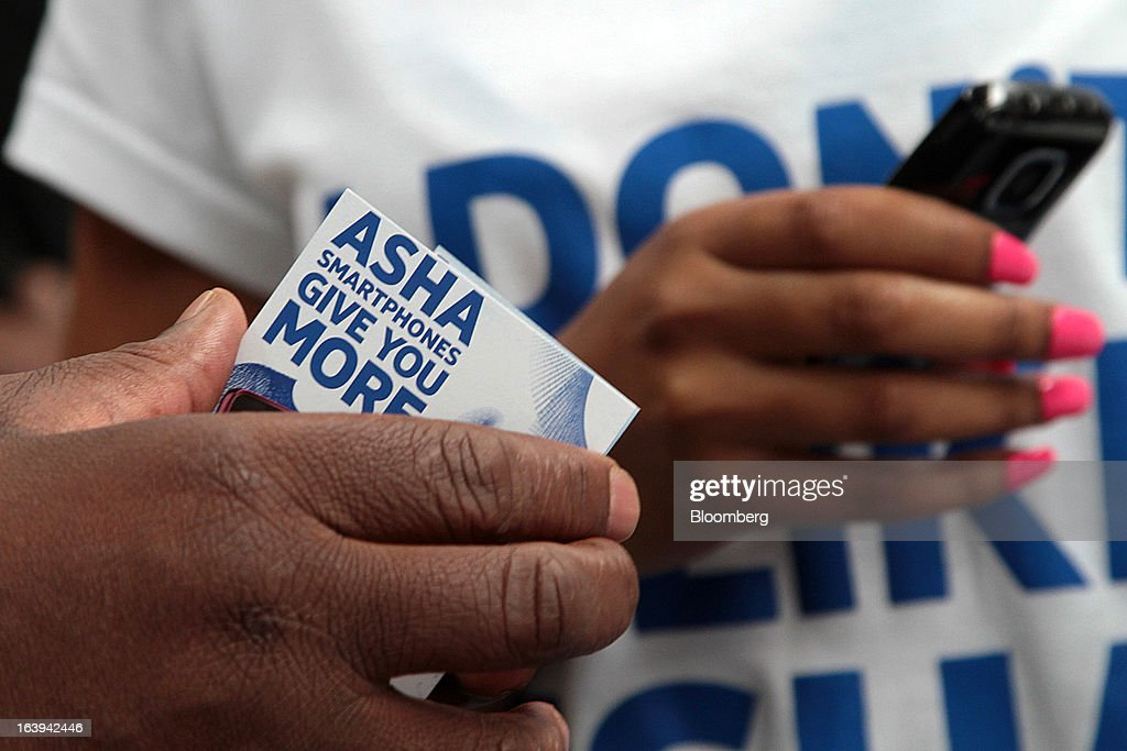 Employees promote new Nokia Asha smartphones to shoppers during a promotional 'activation day' event by Nokia Oyj in Maponya Mall in Soweto, South Africa, on Saturday, March 16, 2013. Nokia, based in Espoo, Finland, introduced three phones for its Asha line, sold primarily in emerging markets. Photographer: Nadine Hutton/Bloomberg via Getty Images
