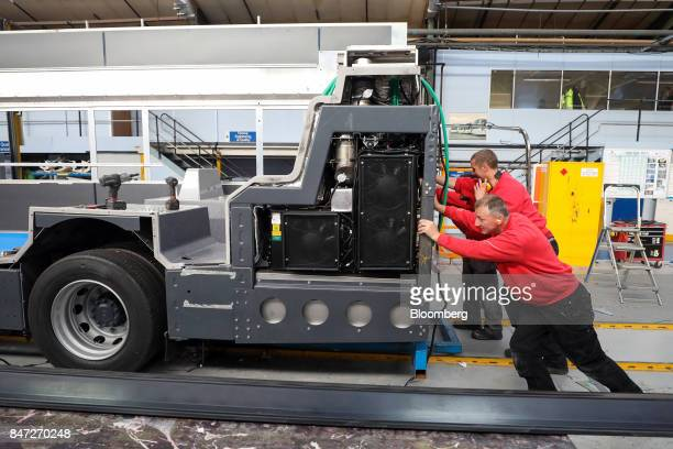 Employees push an Enviro 400 bus along the production line at the Alexander Dennis Ltd factory in Scarborough UK on Wednesday Sept 13 2017...