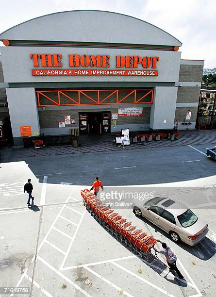 Employees push shopping carts in front of the entrance of a Home Depot home improvement warehouse store August 15 2006 in Colma California Home Depot...