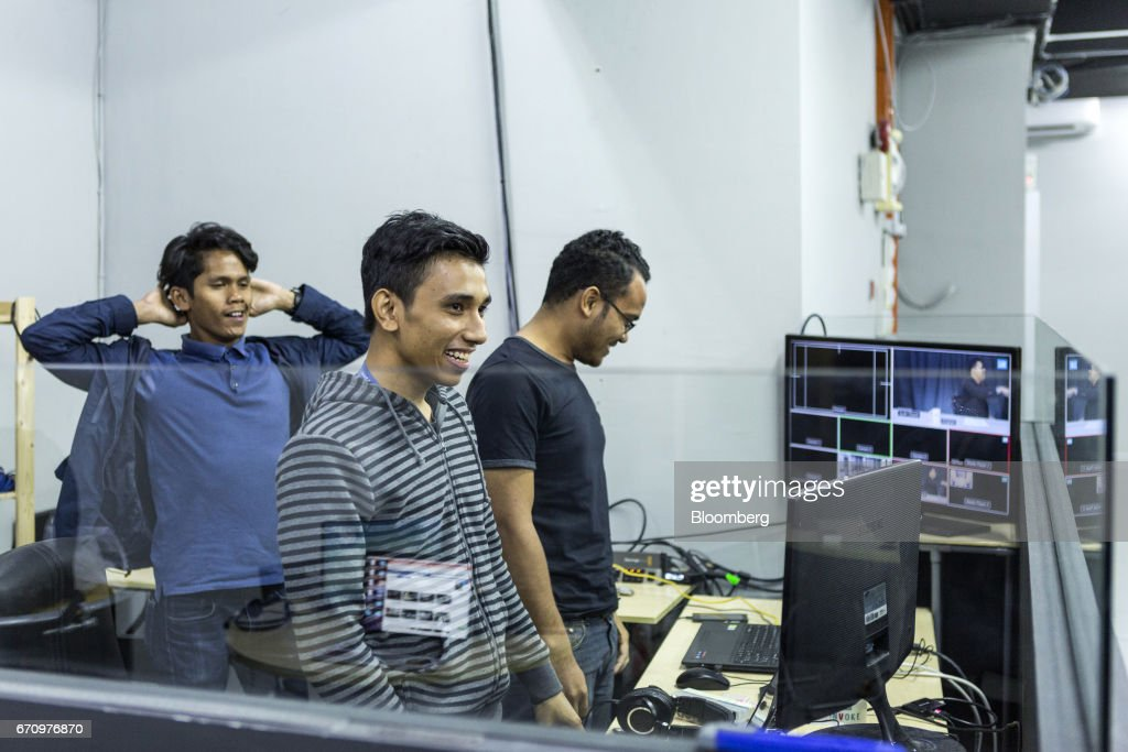 Employees react after a live internet broadcast at Invoke's office in Kuala Lumpur, Malaysia, on Tuesday, April 18, 2017. Invoke is a policy research shop with about 80 employees set up last October by Rafizi Ramli, vice president of the opposition Peoples Justice Party, or PKR. He calls the data operation his secret weapon to oust Prime Minister Najib Razak in an election expected this year. Photographer: Charles Pertwee/Bloomberg via Getty Images