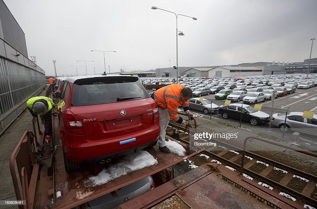 Employees secure newly-manufactured Skoda Fabia automobiles on rail wagons transport trucks before distribution at the Skoda Autos AS plant in Mlada Boleslav, Czech Republic, on Friday, March 15, 2013. VW, which also owns the Porsche luxury-auto brand as well as the Skoda and Seat volume marques, will build at least 10 plants globally, including seven in China, Martin Winterkornm chief executive officer of Volkswagen AG, said. Photographer: Martin Divisek/Bloomberg via Getty Images