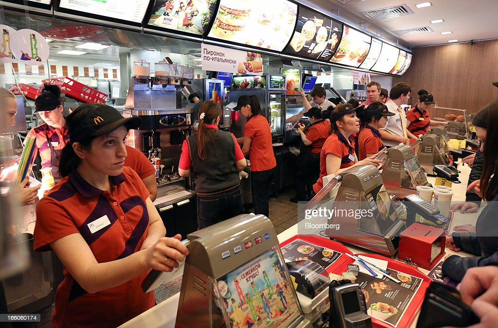 Employees serve customers at the service counter of a McDonald's food restaurant in Moscow, Russia, on Sunday, April 7, 2013. McDonald's Corp., which virtually created the market for burgers and fries in the country and convinced Russians it's OK to eat with their hands, must fend off a growing challenge from rivals Burger King Worldwide Inc., Subway Restaurants, Yum! Brands Inc. and Wendy's Co. Photographer: Andrey Rudakov/Bloomberg via Getty Images