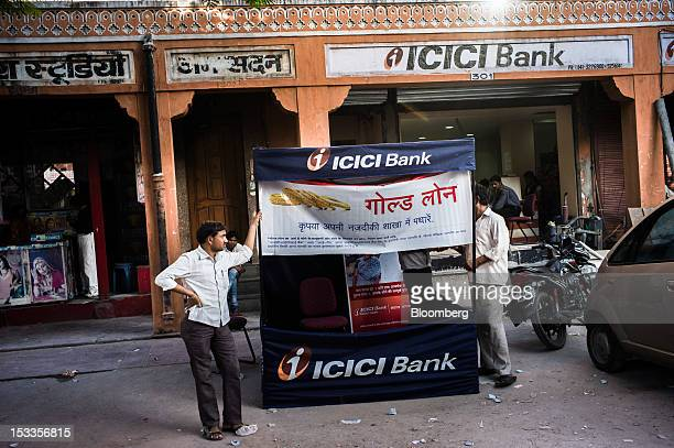 Employees set up a stand advertising loans outside an ICICI Bank Ltd branch in Johari Bazaar in Jaipur Rajasthan India on Wednesday Oct 3 2012 The...