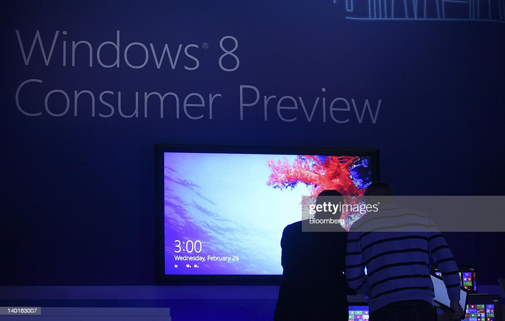 Employees set up tablet devices to show the Windows 8 homepage before a Microsoft Corp. Windows 8 software consumer preview event at the Mobile World Congress in Barcelona, Spain, on Wednesday, Feb. 29, 2012. The Mobile World Congress, operated by the GSMA, expects 60,000 visitors and 1400 companies to attend the four-day technology industry event which runs Feb. 27 through March 1. Photographer: Chris Ratcliffe/Bloomberg via Getty Images