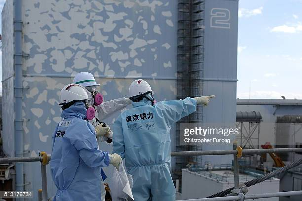TEPCO employees show a member of the media the decontamination and decommissioning process at the Tokyo Electric Power Co's embattled Fukushima...