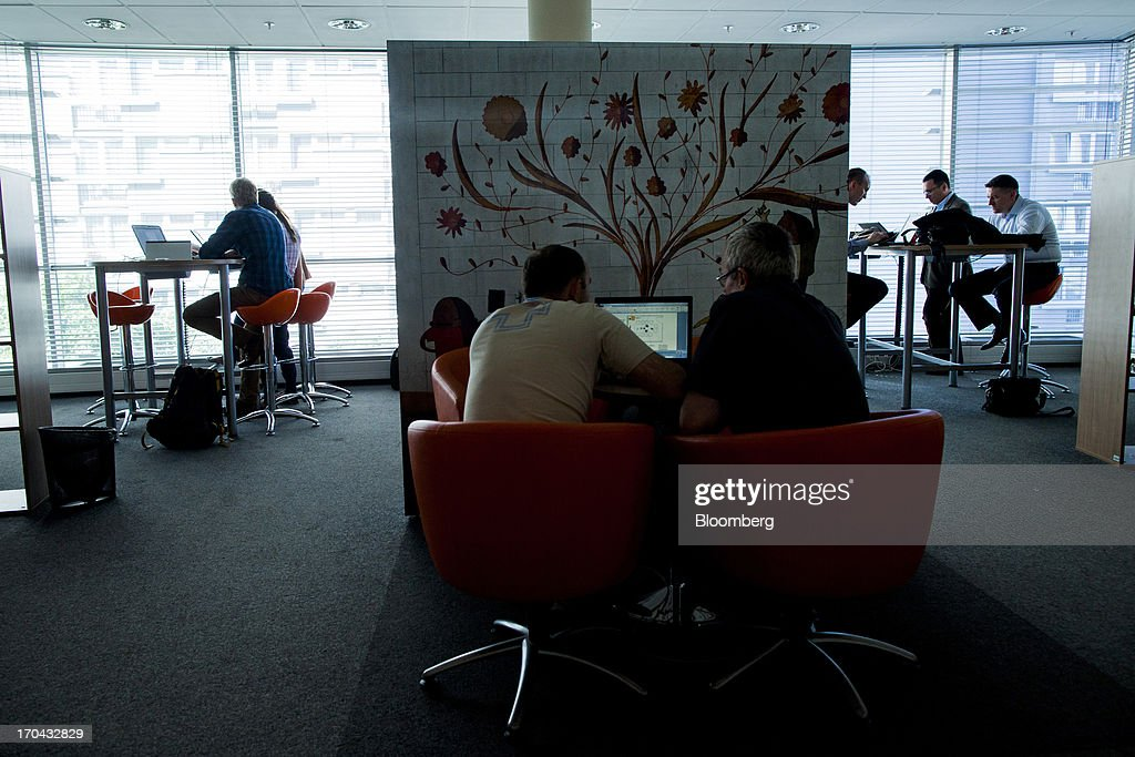 Employees sit and work on laptop computers inside the headquarters of Orange Polska, also known as Telekomunikacja Polska SA (TPSA), Poland's national telecommunications company, in Warsaw, Poland, on Wednesday, June 12, 2013. Cable providers are being drawn to Poland, the European Union's biggest eastern economy, because penetration levels are half that of neighboring Germany even as unemployment rises, according to a website presentation by the country's biggest TV network, Cyfrowy Polsat SA. Photographer: Bartek Sadowski/Bloomberg via Getty Images