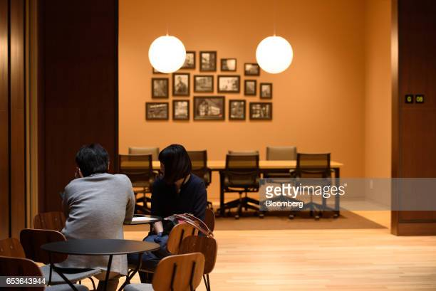 Employees sit in a foyer at Fast Retailing Co's Uniqlo City Tokyo office in Tokyo Japan on Friday March 10 2017 Uniqlo owner Fast Retailing is...