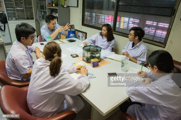 Employees sit in a meeting at an office in the Nithi Foods Co factory in the San Pa Tong district of Chiang Mai Thailand on Tuesday May 23 2017...