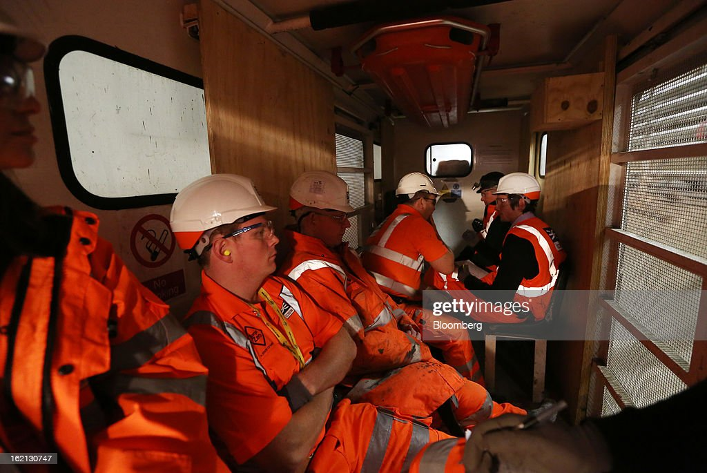 Employees sit inside a works locomotive as it travels through one of new western tunnels, developed by Crossrail, beneath London, U.K., on Tuesday, Feb. 19, 2013. Network Rail Ltd. projects include a 6 billion-pound upgrade to the Thameslink line that spans London from north to south and the Crossrail project to build an east-west line through the capital, Finance Director Patrick Butcher said. Photographer: Chris Ratcliffe/Bloomberg via Getty Images