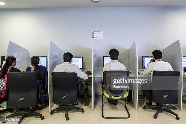 Employees sit working at computers in the library of the Tata Consultancy Services Ltd campus in the State Industries Promotion Corporation of Tamil...