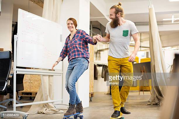 Employees skating through the office