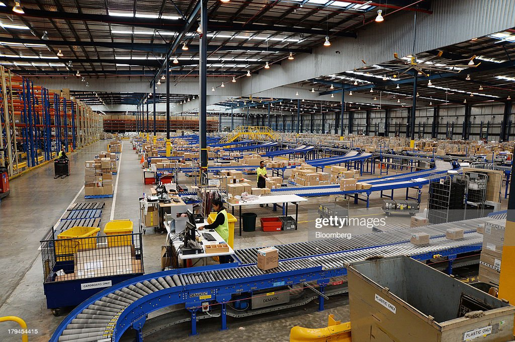 Employees sort boxes of merchandise as they travel along conveyors to be sorted and distributed at the Myer Holdings Ltd. distribution center in Melbourne, Australia, on Tuesday, Sept. 3, 2013. A Bureau of Statistics report released in Sydney on Sept. 4 showed household spending climbed 0.4 percent in the second quarter, adding 0.2 percentage point to gross domestic product growth. Photographer: Carla Gottgens/Bloomberg via Getty Images