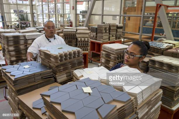 Employees stack tile pieces to be packaged at the Heath Ceramics Ltd production facility in San Francisco California US on Friday June 2 2017 The US...