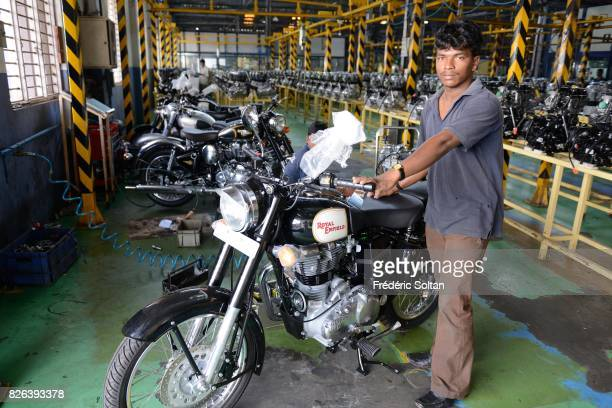 Employees stand among Royal Enfield Motors Ltd motorcycles on the production line at the company's manufacturing facility in Chennai on January 20...