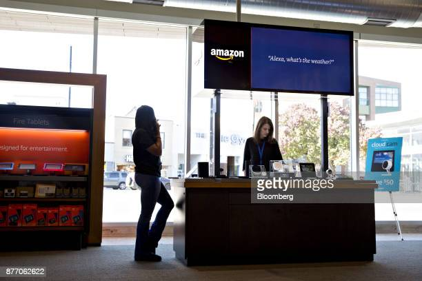 Employees stand at an Amazoncom Inc PopUp store stands inside the Lakeview Whole Foods Market Inc store in Chicago Illinois US on Monday Nov 20 2017...