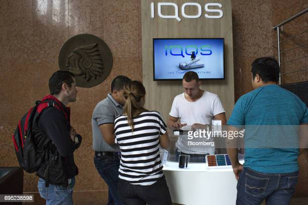 Employees stand in line to purchase vaporizers in the lobby of the Philip Morris International Coltabaco SAS production facility in Medellin Colombia...