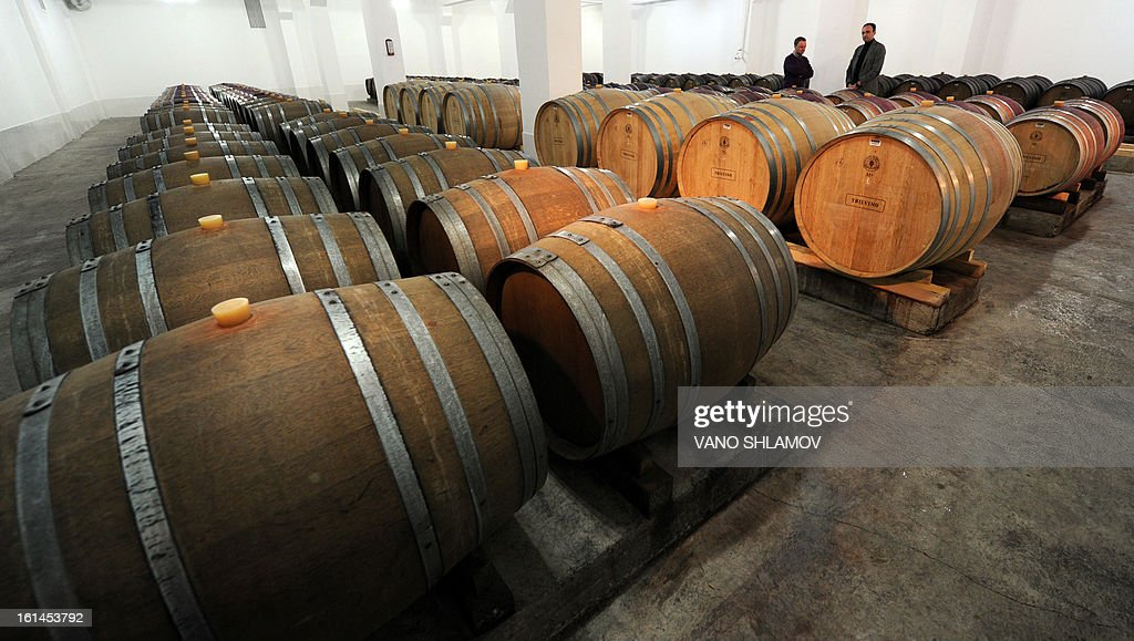 Employees stand in storage at a winery in Tbilisi, on February 11, 2013. Georgian officials held recently talks in Moscow to agree a mechanism on lifting the Russian trade embargo on Georgian wine and mineral water.