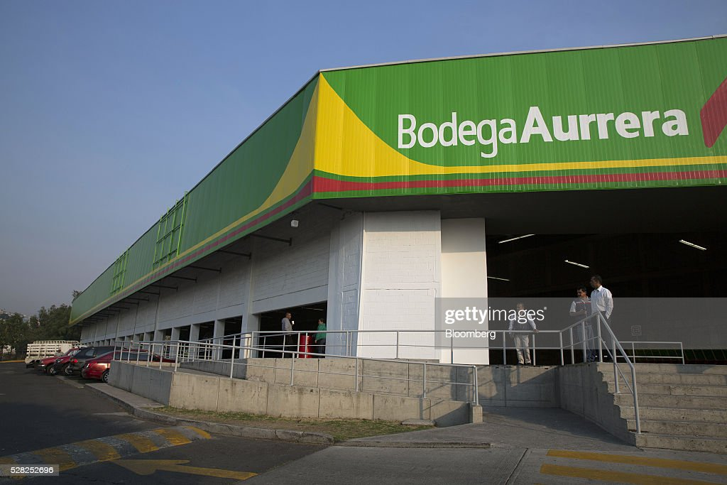 Employees stand outside a Bodega Aurrera store, the discount chain owned by Wal-Mart Stores Inc., in Naucalpan de Juarez, Mexico, on Wednesday, May 4, 2016. Wal-Mart de Mexico SAB reported first-quarter results last week that beat analysts estimates, the most recent sign of growth for Mexican companies this earnings season. Photographer: Susana Gonzalez/Bloomberg via Getty Images