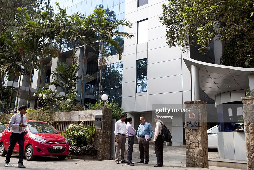 Employees stand talking outside the Sun Pharmaceutical Industries Ltd. corporate office in the Andheri suburb of Mumbai, India, on Monday, April 7, 2014. Sun Pharmaceutical, India's largest drugmaker by market value, agreed to buy Ranbaxy Laboratories Ltd. for $3.2 billion in stock, the biggest purchase by an Indian company in two years. Photographer: Amit Madheshiya/Bloomberg via Getty Images