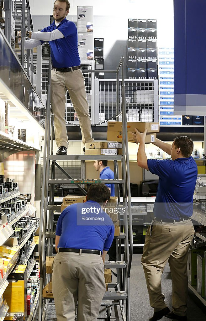 Employees stock computers running the Microsoft Corp. Windows 8 operating system at a Best Buy Co. store in Orem, Utah, U.S., on Friday, Oct. 26, 2012. Microsoft Corp. introduced the biggest overhaul of its flagship Windows software in two decades, reflecting the rising stakes in its competition with Apple Inc. and Google Inc. for the loyalty of customers who are shunning personal computers and flocking to mobile devices. Photographer: George Frey/Bloomberg via Getty Images