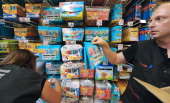 Employees stock school supplies on the racks of a supermarket in Strasbourg eastern France on August 22 two weeks ahead the start of classes AFP...