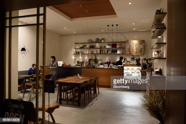 Employees take a break inside a cafe at Fast Retailing Co's Uniqlo City Tokyo office in Tokyo Japan on Friday March 10 2017 Uniqlo owner Fast...
