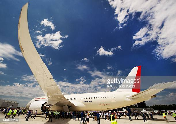 Employees take photos after the new Boeing 787 Dreamliner built for Air India is rolledoff the production line at Boeing's new production facilities...