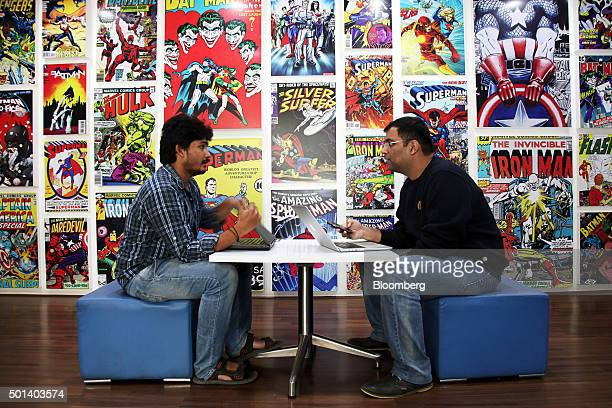 Employees talk at a desk in the office of Myntracom a unit of Flipkart Internet Services Pvt in Bangaluru India on Friday Dec 04 2015 Discounts and...