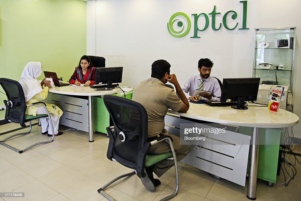 Employees talk to customers at the Pakistan Telecommunications Co. (PTCL) sales and customer care center in Islamabad, Pakistan, on Wednesday, Aug. 21, 2013. Pakistan Telecommunication, the countrys biggest fixed-line phone-service provider, said second-half sales growth will at least match the pace of the previous six months as broadband demand increases. Photographer: Asad Zaidi/Bloomberg via Getty Images
