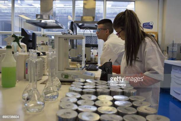 Employees test tobacco in the lab area of the Philip Morris International Coltabaco SAS production facility in Medellin Colombia on Friday June 2...