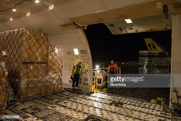 Employees unload cargo from the hold of a Boeing Co 747 jet at TNT Express NV's European mail hub at Liege Airport in GraceHollogne Belgium on Friday...