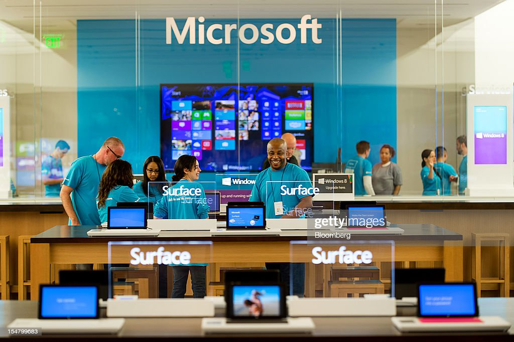 Employees wait for customers at the opening of a Microsoft Corp. store in Bellevue, Washington, U.S., on Friday, Oct. 26, 2012. Microsoft Corp. introduced the biggest overhaul of its flagship Windows software in two decades, reflecting the rising stakes in its competition with Apple Inc. and Google Inc. for the loyalty of customers who are shunning personal computers and flocking to mobile devices. Photographer: Stuart Isett/Bloomberg via Getty Images