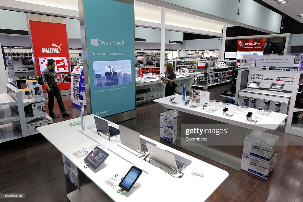 Employees wait to assist customers as various electronics products are displayed for sale at a Future Shop store in Vancouver, British Columbia, Canada, on Thursday, March 7, 2013. Future Shop, Canada's largest consumer electronics retailer, offers home and entertainment products, including televisions, computers, cameras, MP3 players, video games, computer add-ons, software, and audo and video systems. Photographer: Deddeda White/Bloomberg via Getty Images