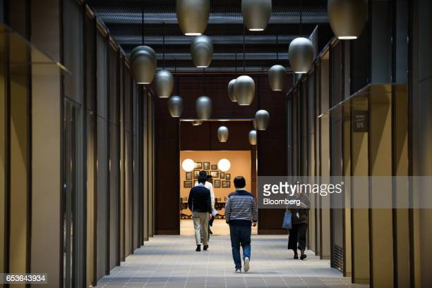 Employees walk inside Fast Retailing Co's Uniqlo City Tokyo office in Tokyo Japan on Friday March 10 2017 Uniqlo owner Fast Retailing is betting that...
